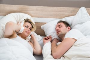 man snoring keeping wife up
